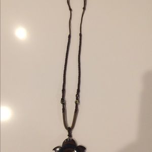 Jewelry - Brown necklace with brown/black pendant
